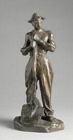 """sculpture d""""un homme avec un chapeau et tenant une pelle"""